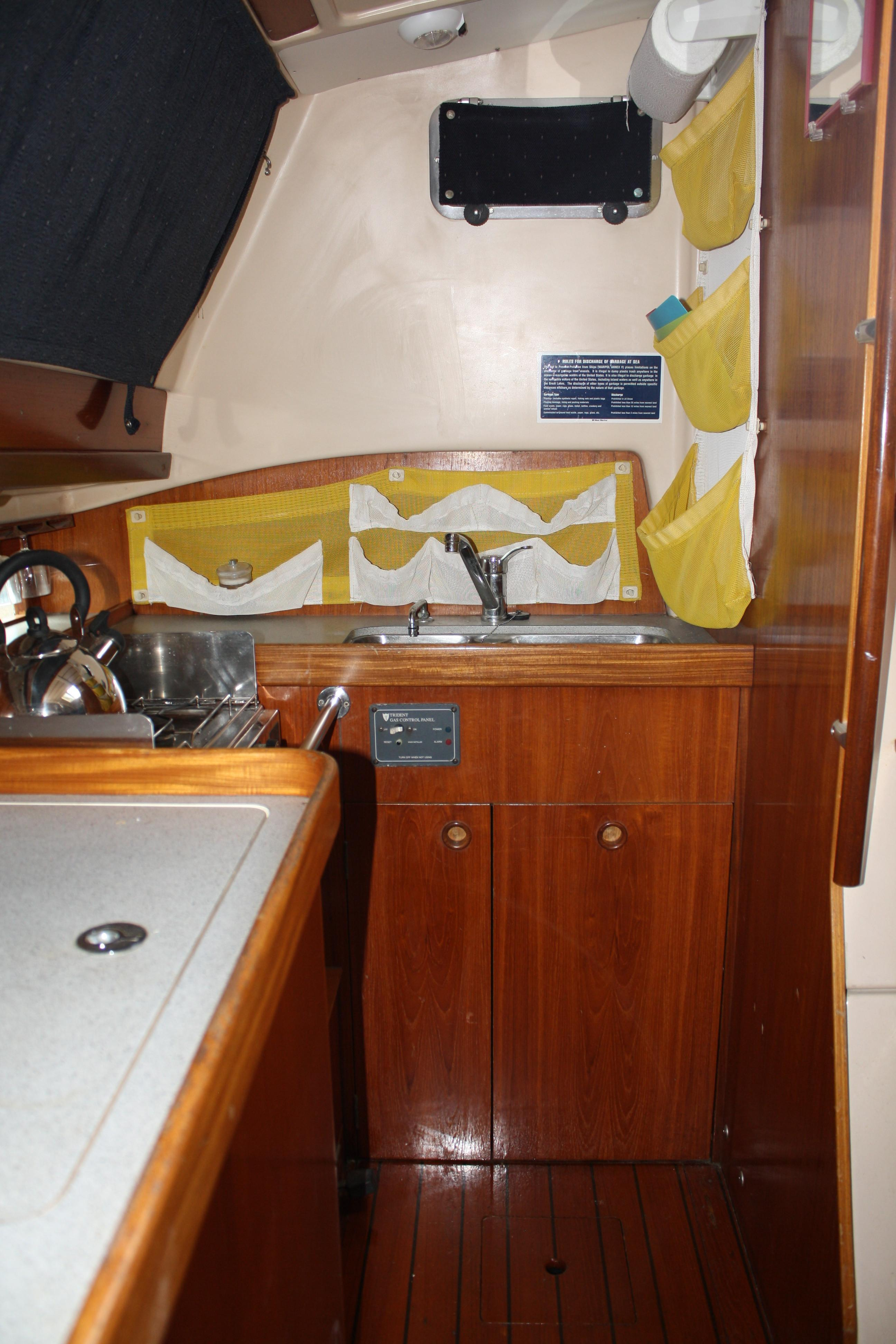 The majority of the galley is to starboard and just aft of the companionway with easy access to the  large fridge and freezer