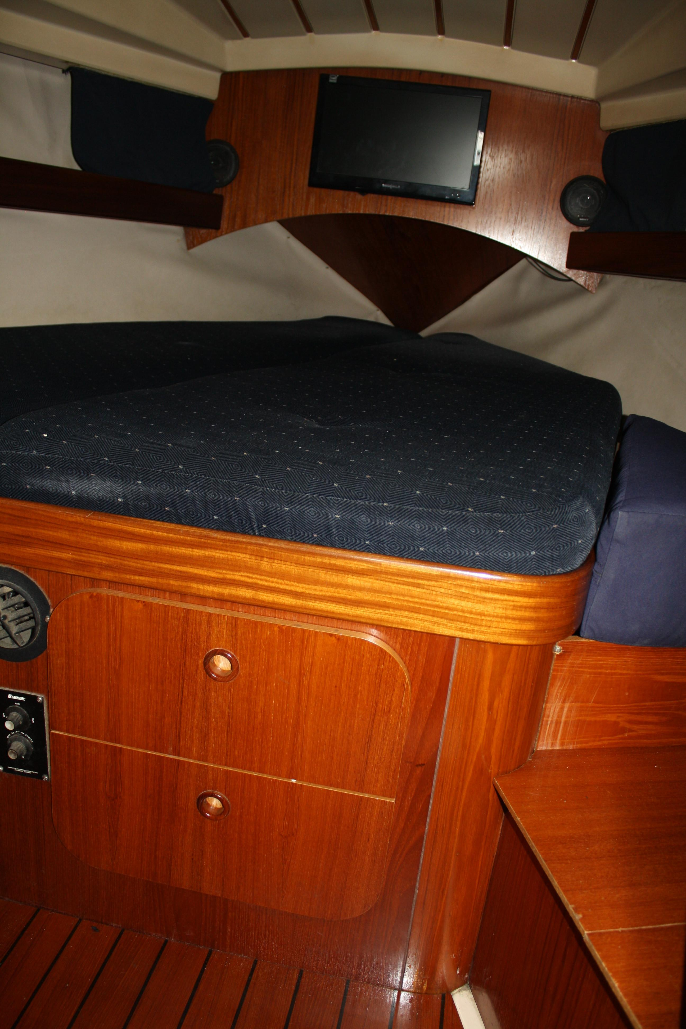 A good size V berth with storage makes up the owners stateroom.
