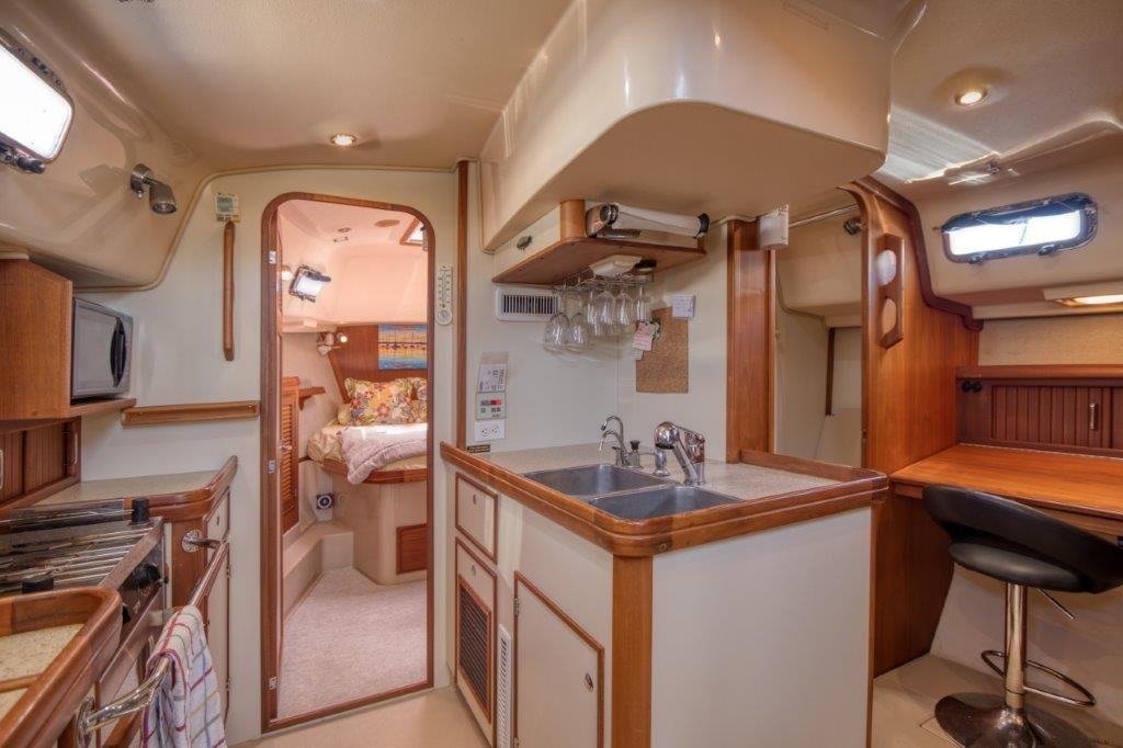 Galley and desk with seat