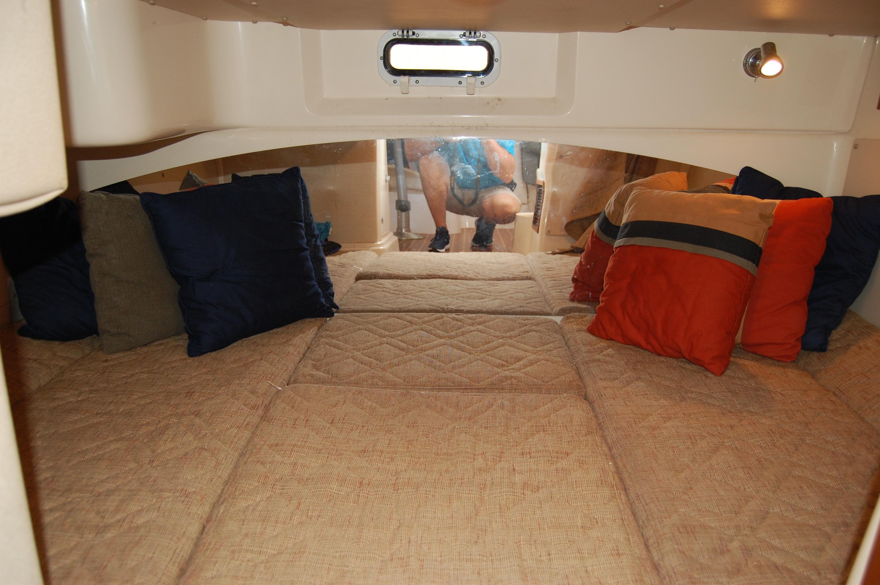 2002 Grady White 330 Express, mid-cabin sleep/storage compartment