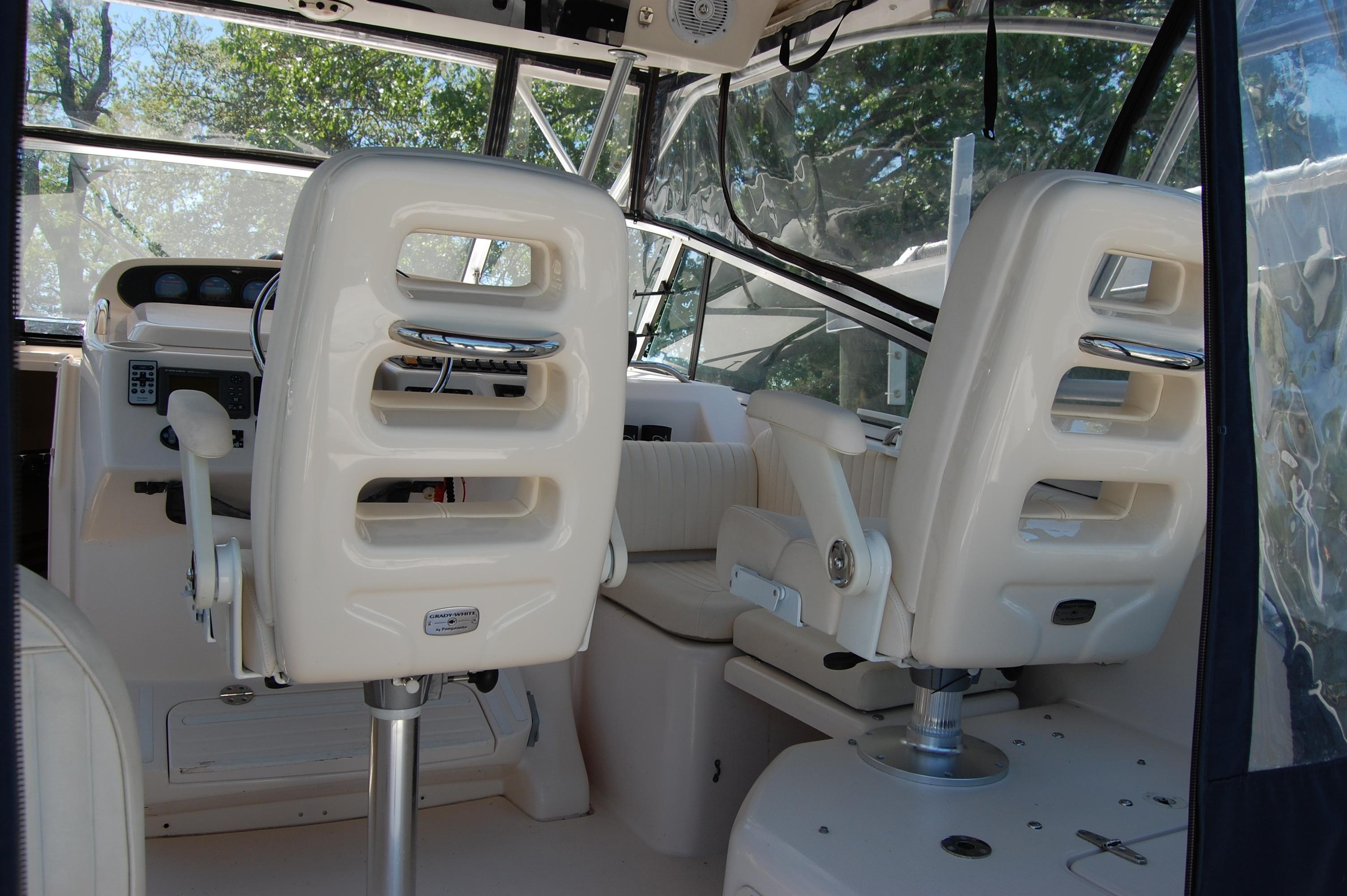 2002 Grady White 330 Express,  the Stbd side Pedestal seat in unique to this vessel