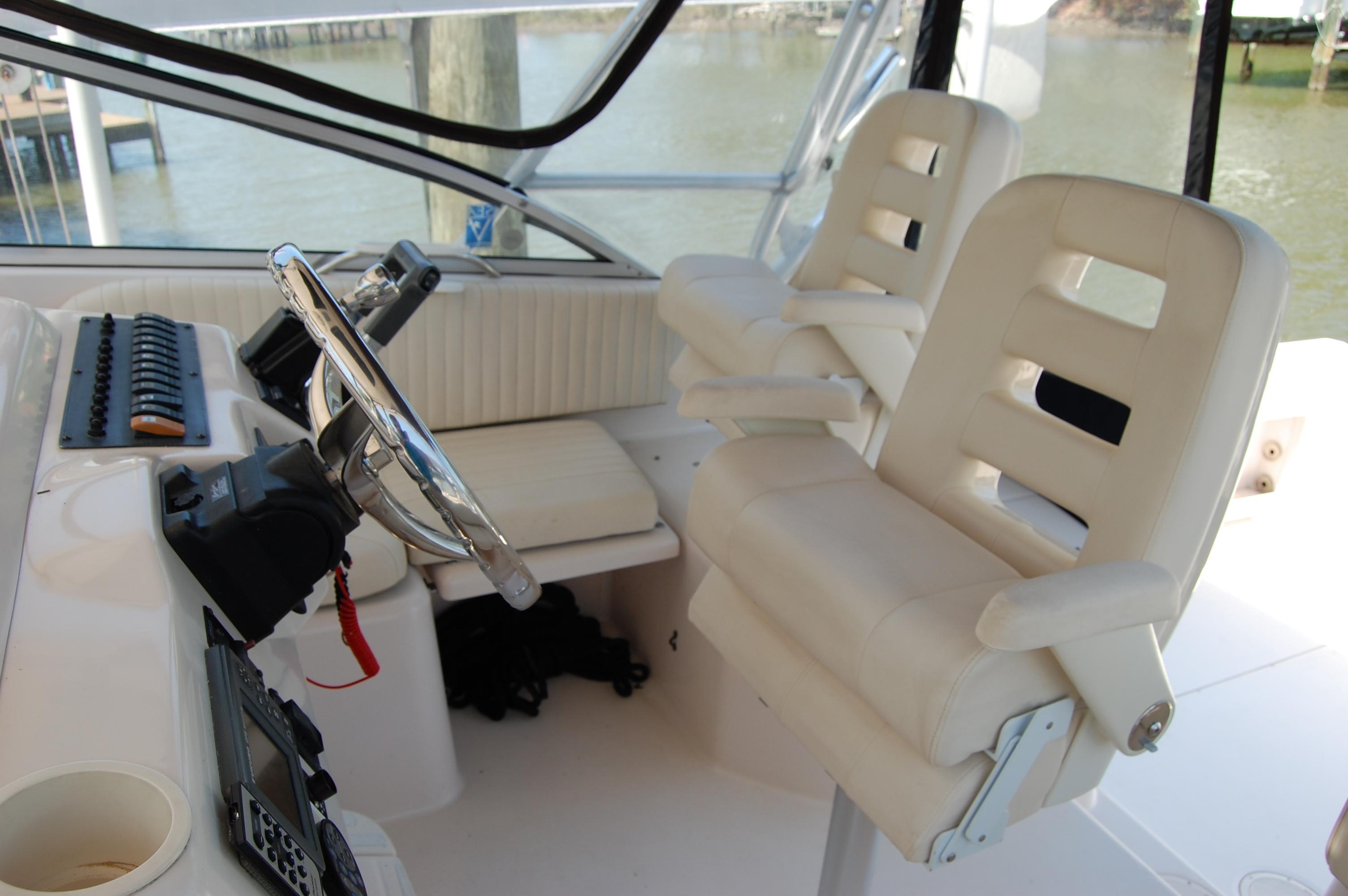 2002 Grady White 330 Express, (2) Pompanette helm chairs (flip-up bolsters, folding armrests)