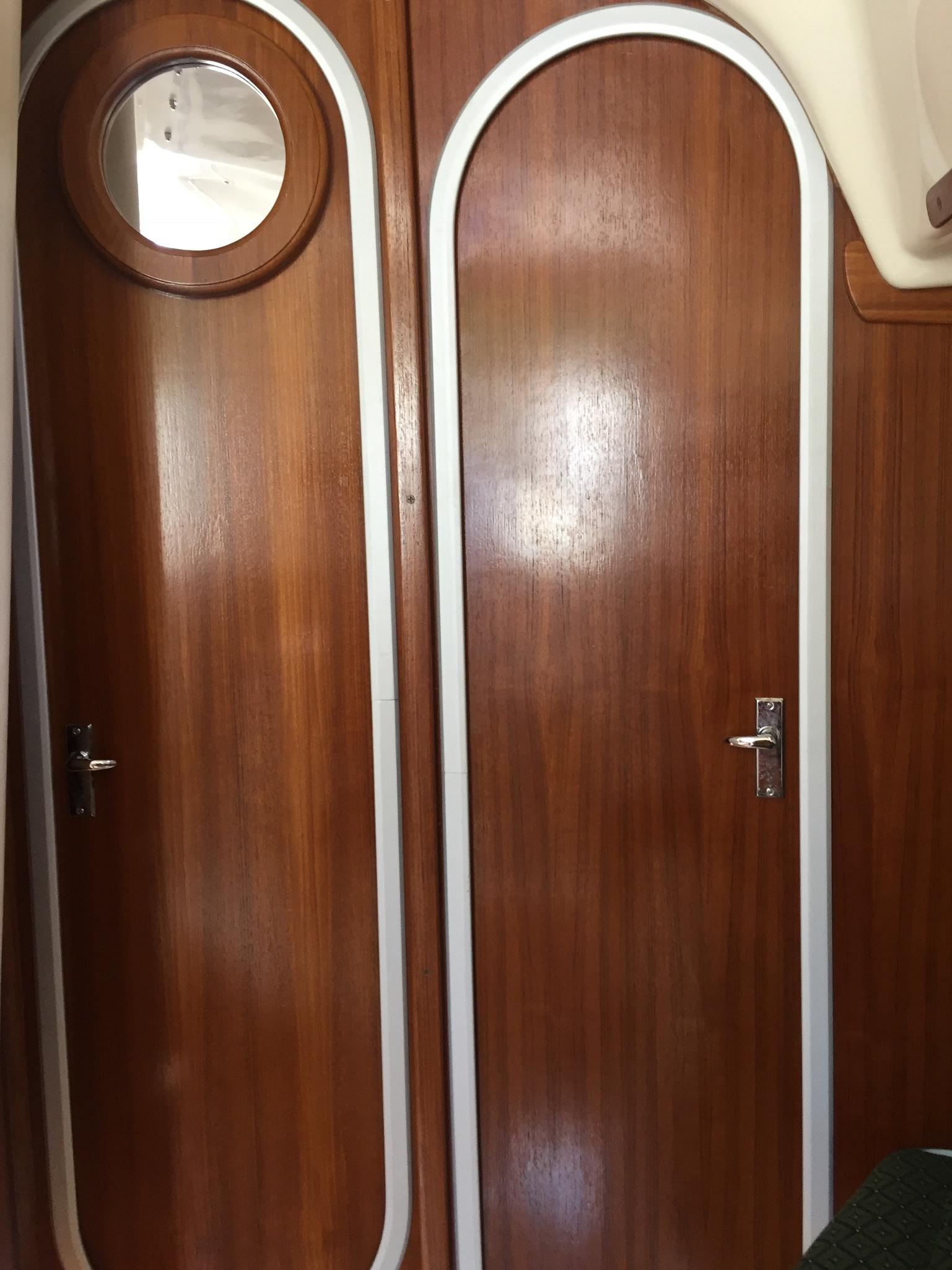 Privacy doors; port to head/stbd to fwd berth