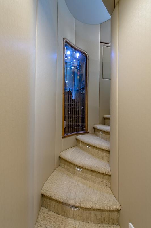 Curved Stairwell & Lighted Rod Storage