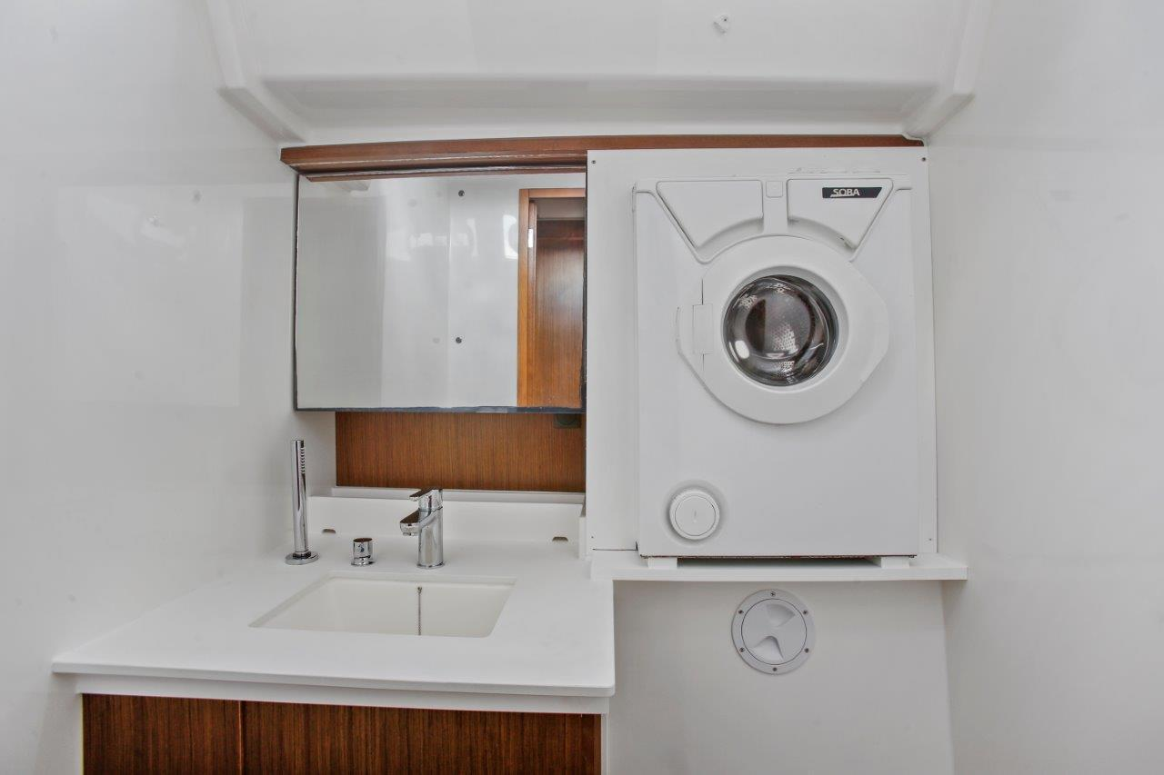 Washing Machine and sink in starboard aft utility roomad