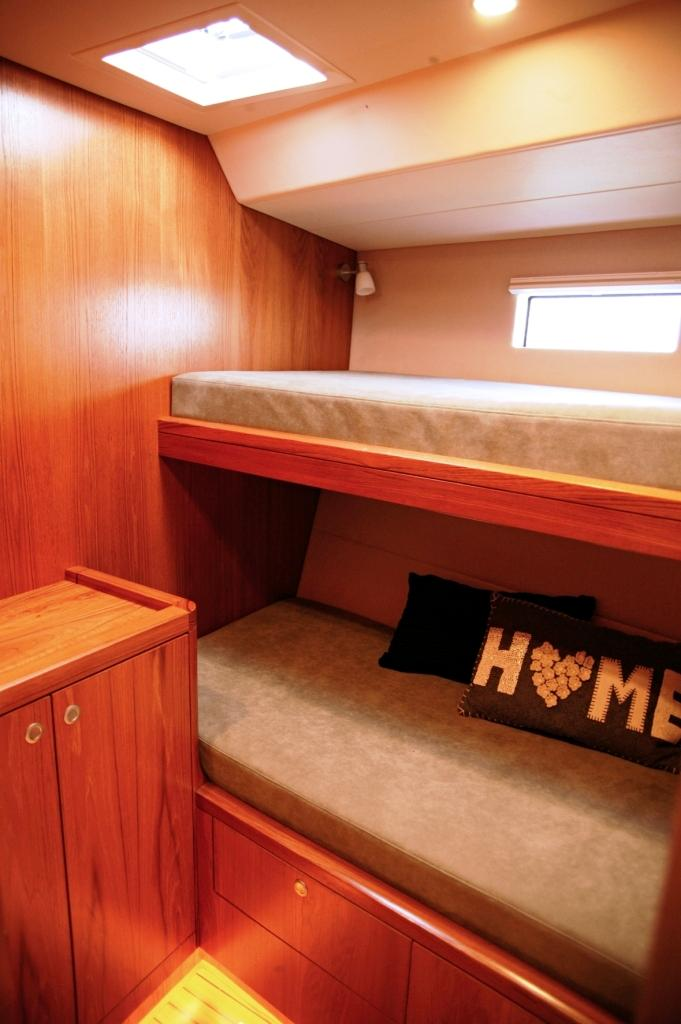Third cabin with storage under berth