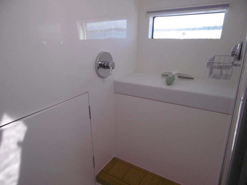Master shower has a seat, port light and opening hatch