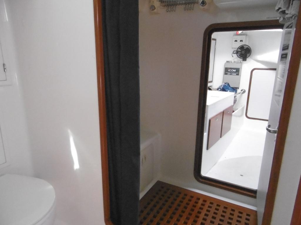 Aft of the shower is a brilliant work area with bench
