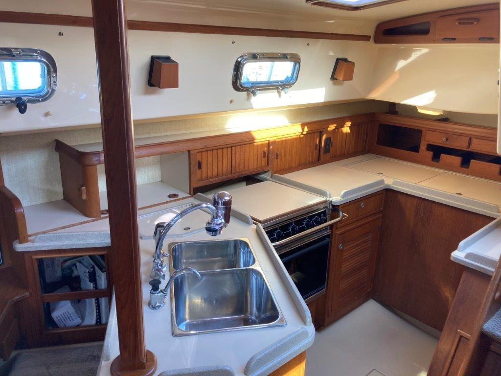 Galley with stove/over, sink, refrigeration and freezer